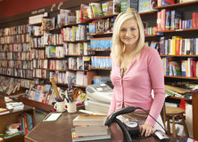 Female bookshop proprietor. Smiling at camera