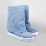 Female  boots over white Royalty Free Stock Images