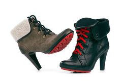 Female boots with red sole over white royalty free stock image