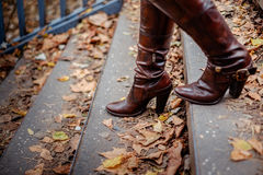 Female boots walking down the stairs Royalty Free Stock Photos
