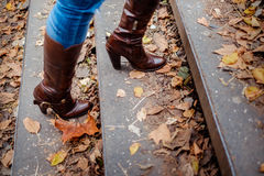 Female boots walking up the stairs. On cold fall day Stock Photos