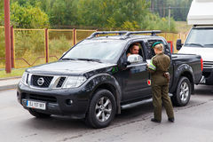 A female border guard checks the documents Royalty Free Stock Photo