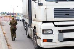 A female border guard checks the documents Stock Photo