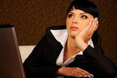 A female boss. Female boss dreams at table in office Stock Photos