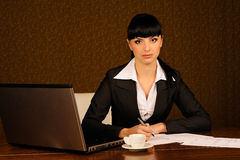 A female boss. Female boss at table in office Royalty Free Stock Photos