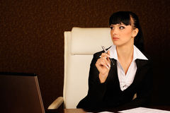 A female boss. Female boss at table in office Royalty Free Stock Images