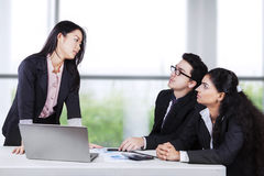 Female boss angry on her workers Royalty Free Stock Photo