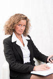 Female Boss with calendar and smartphone Royalty Free Stock Photo