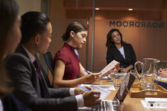 Female boss chairing business meeting in boardroom, close up royalty free stock photography