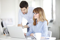 Female boss consulting with her colleague Stock Photo