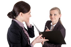 Female Boss dictate. Picture of a business womangives a dictation to her clerk Stock Image