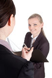 Female Boss dictate. Picture of a business women gives a dictation to her clerk Royalty Free Stock Image
