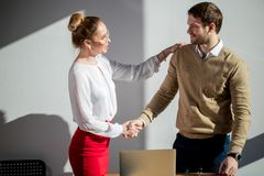 Businesswoman handshake with businessman -greeting, dealing concepts stock photo
