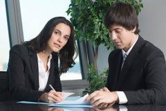 Female boss signing documents Royalty Free Stock Image