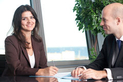 Female boss signing documents Royalty Free Stock Photography