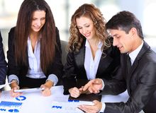 Female boss talking to business team Stock Photos