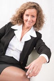Female Boss talking to someone and being happy. Smiling Royalty Free Stock Image