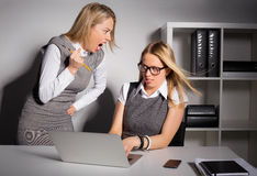 Female boss about to kill her employee with pencil. Female boss yelling and  about to kill her employee with pencil Stock Photography