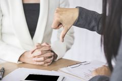Female boss unhappy and disappointed with the project showing hand dislike to the team. While meeting in conference room royalty free stock photo