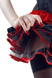 Female bottoms in black and red skirt Stock Photo