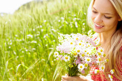 Female with bouquet Royalty Free Stock Image