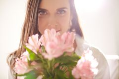 Female with bouquet Stock Images