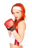 Female boxer. Portrait of pretty female boxer in boxing gloves over white background Royalty Free Stock Images