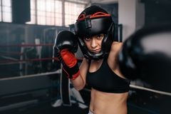 Female boxer in action inside the boxing ring Royalty Free Stock Photos