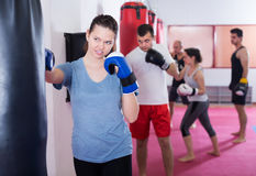 Female  boxer  beating boxing bag Stock Images