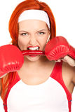 Female boxer with chili pepper. Portrait of pretty female boxer biting hot chili pepper Royalty Free Stock Photography