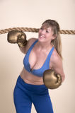 Female boxer coming under the ropes Stock Images
