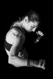 Female boxer in a fighting pose Stock Image