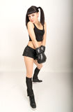 Female boxer, fitness woman boxing wearing boxing black gloves Stock Photos