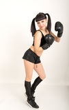 Female boxer, fitness woman boxing wearing boxing black gloves Stock Image