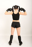 Female boxer, fitness woman boxing wearing boxing black gloves Royalty Free Stock Photo
