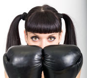 Female boxer, fitness woman boxing wearing boxing black gloves Royalty Free Stock Image