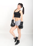 Female boxer, fitness woman boxing wearing boxing black gloves Royalty Free Stock Images