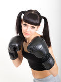 Female boxer, fitness woman boxing wearing boxing black gloves Stock Photography