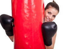 Female boxer holding punching bag Stock Images