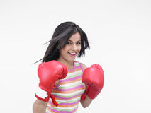 Female boxer of indian origin. Girl of indian origin with red boxing gloves stock photos