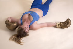 Female boxer laying on floor Stock Photography