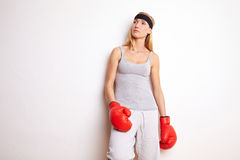 Female boxer leaning on wall royalty free stock photo