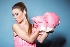 Female boxer model with big fun pink gloves Stock Photography