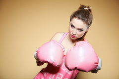 Female boxer model with big fun pink gloves Stock Photos