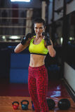 Female boxer performing boxing stance Royalty Free Stock Images