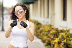 Female boxer posing on the street Stock Photos