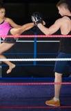 Female boxer practicing an air kick Royalty Free Stock Photos