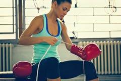 Female Boxer Preparing For Training Stock Image