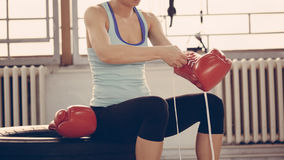 Female Boxer Preparing For Training Stock Photography