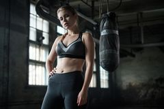 Female Boxer preparing for training in Boxing Club Royalty Free Stock Photo